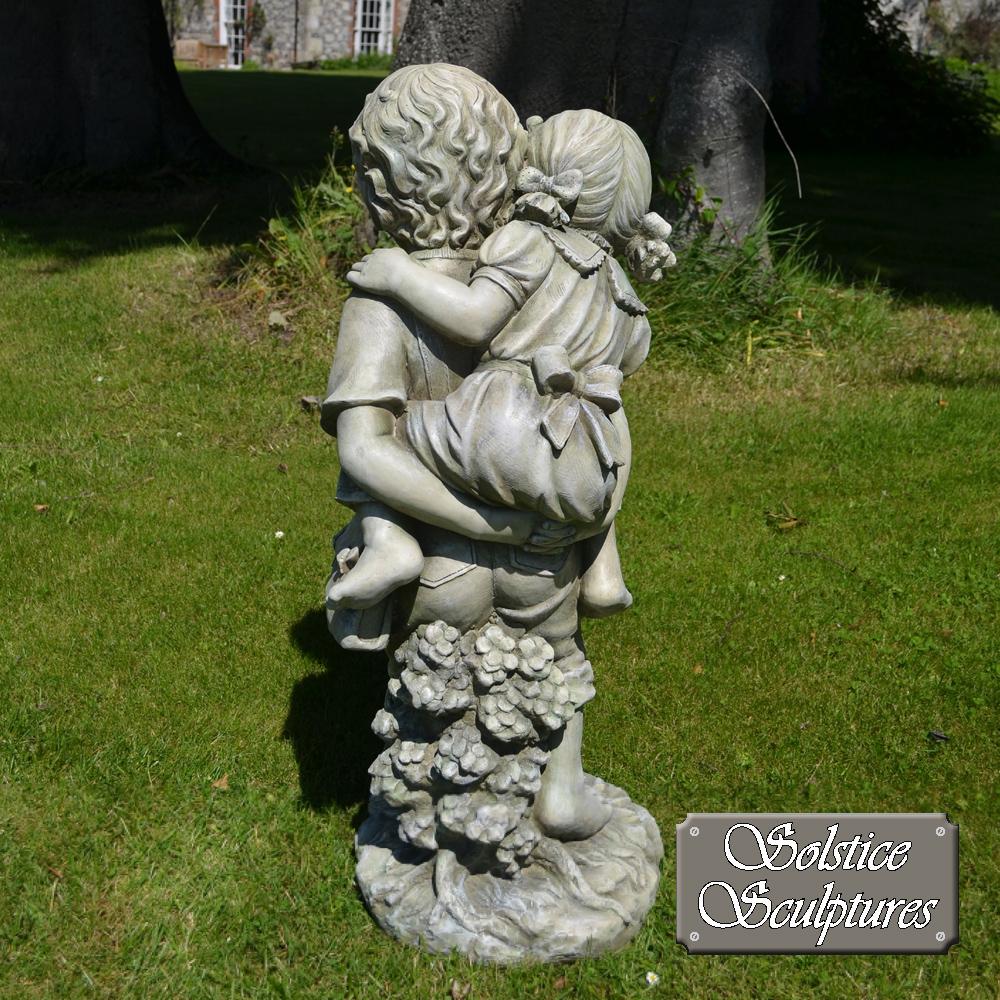 Jane & John garden statue back view