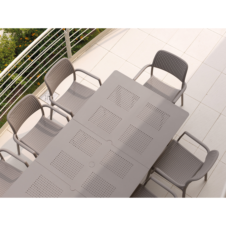 Libeccio table in turtle dove shown with Bora chairs