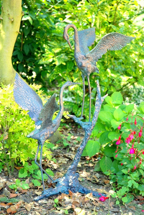 Pair of Cranes on wooden branch
