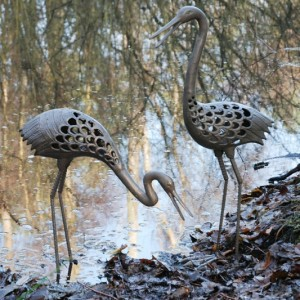 Cast iron herons 79 and 54cm tall