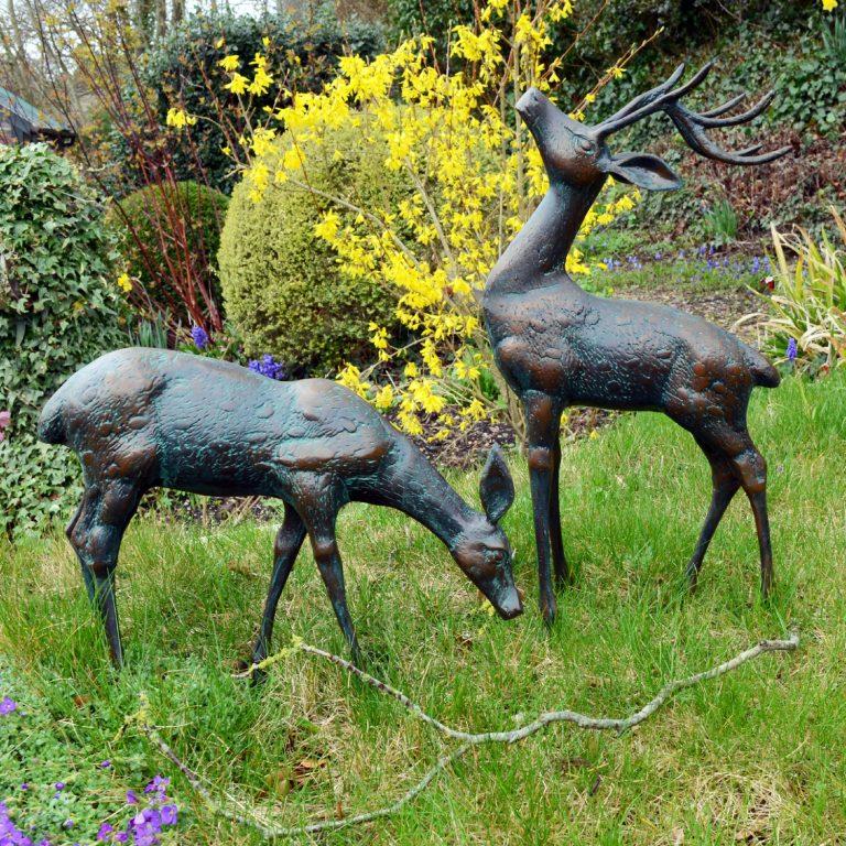 Pair of small deer in dark verdigris finish