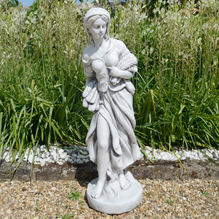 Annie in autumn garden statue