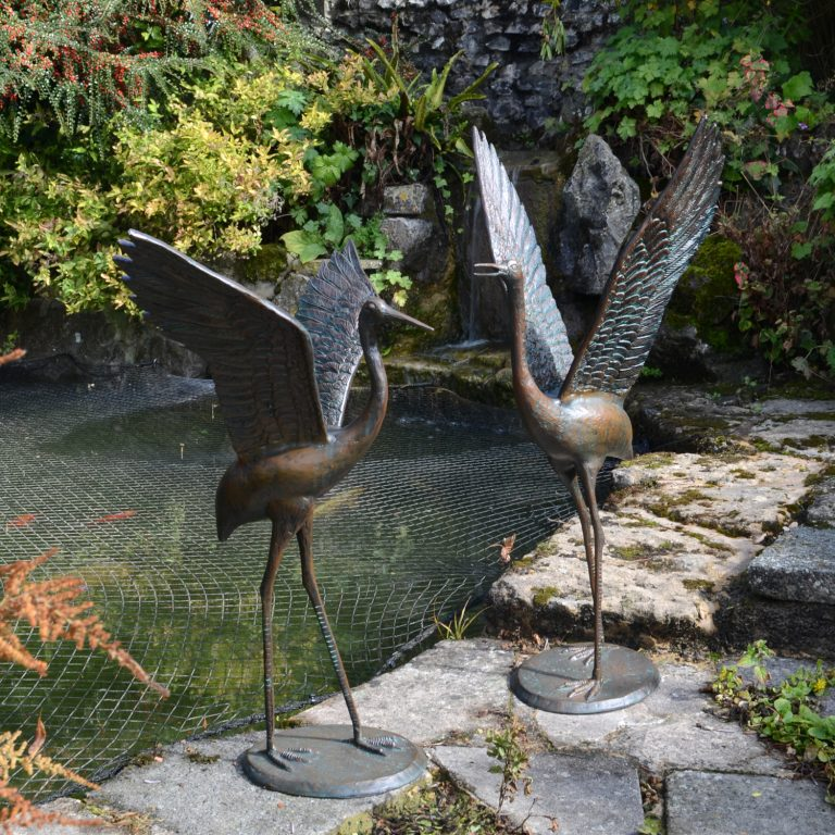 bronze cranes outstretched wings main