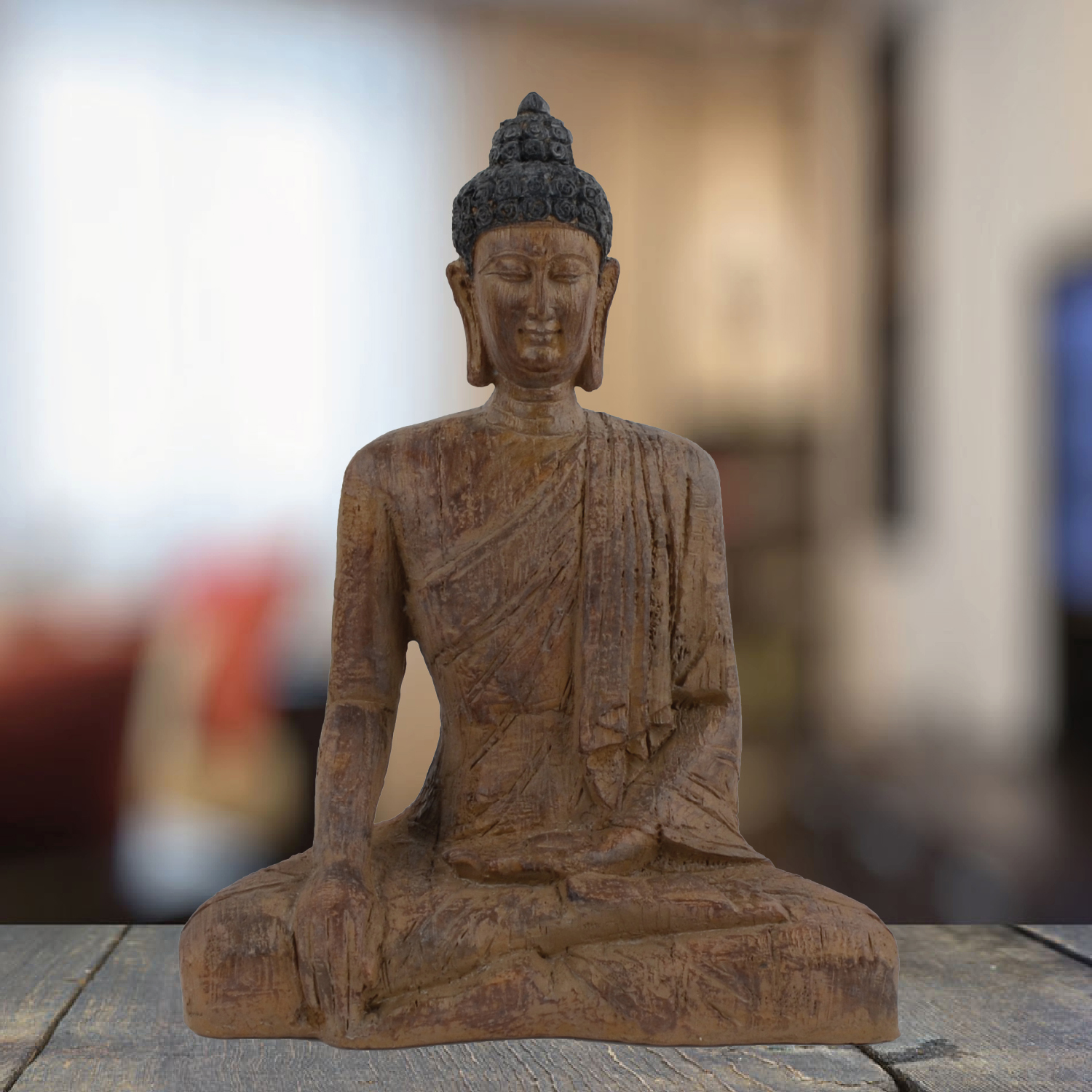 Sitting Buddha statue in carded wood effect.